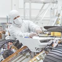 Technician working on JPL NASA Mars Rover in cleanroom NASA/JPL-Caltech