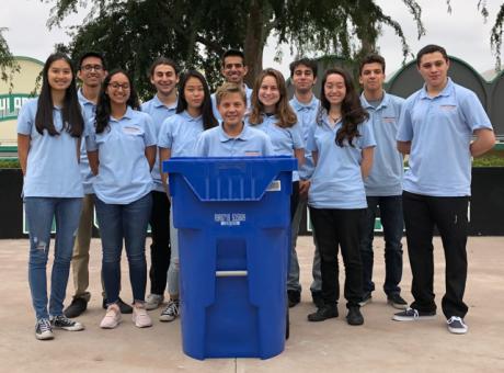 Granada Hills Charter School Students standing behind recycle bin